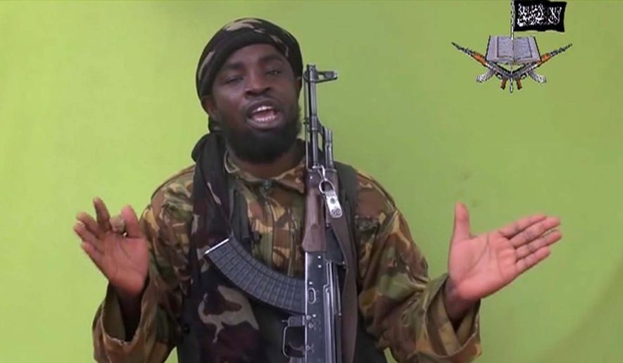 This file photo taken from video by Nigeria's Boko Haram terrorist network, Monday, May 12, 2014, shows their  leader Abubakar Shekau speaking to the camera. (AP Photo) (Associated Press) ** FILE **