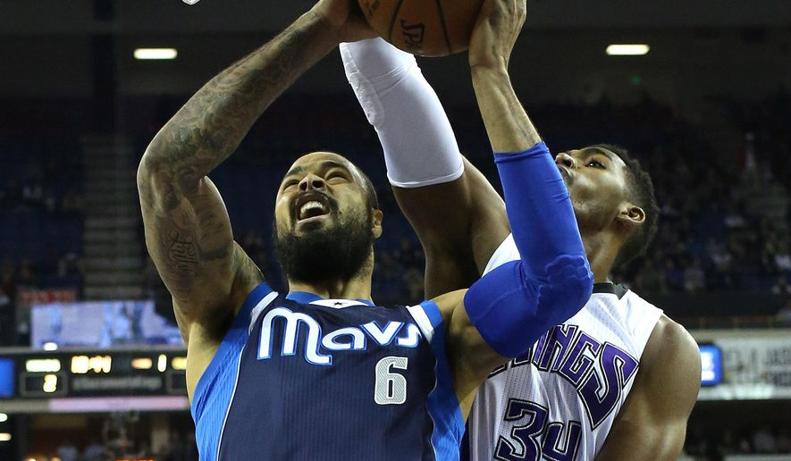 Dallas Mavericks center Tyson Chandler, left, goes to the basket against Sacramento Kings forward Jason Thompson during the first quarter of an NBA basketball game in Sacramento, Calif., Tuesday, Jan. 13, 2015. (AP Photo/Rich Pedroncelli)