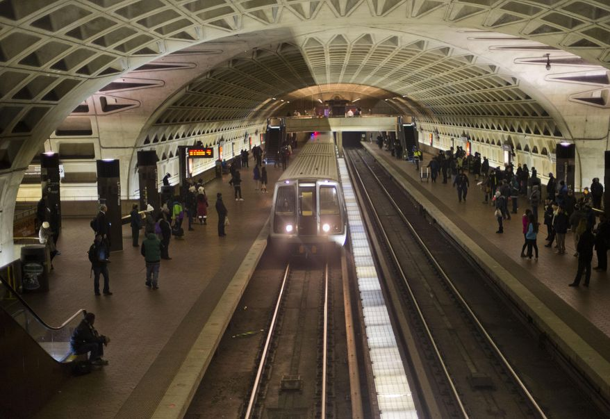 A subway train arrives Jan. 13, 2015, at the L'Enfant Metro Station in Washington, which is part of the region's public mass transit network. (Associated Press) **FILE**