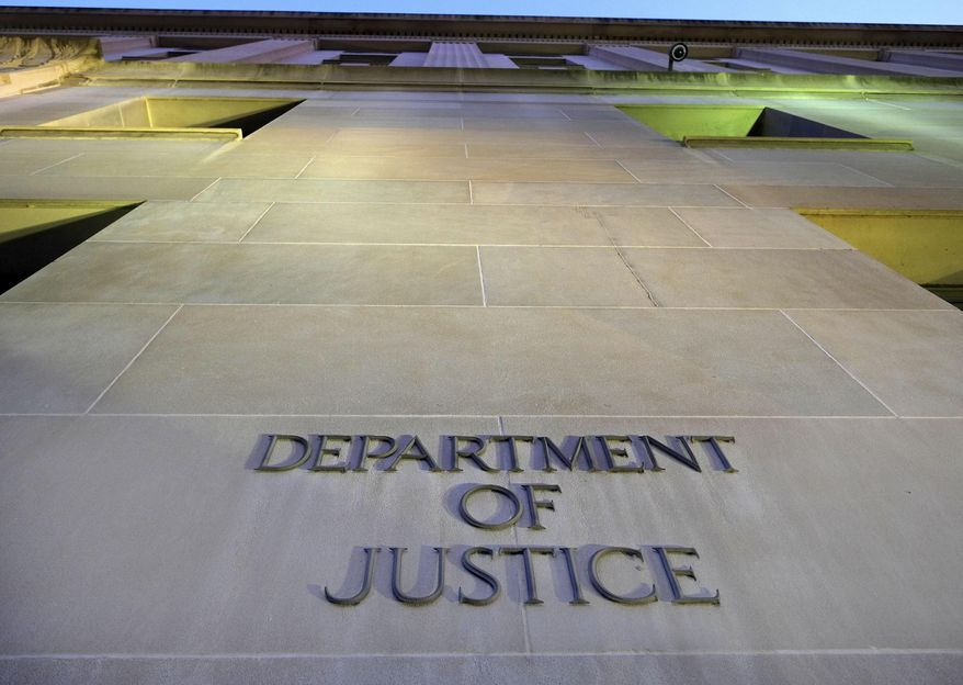 In this May 14, 2013 photo, the U.S. Department of Justice headquarters building is seen in Washington.   (AP Photo/J. David Ake, File)