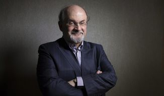 This Sept. 8, 2012, file photo shows author Salman Rushdie posing during the 2012 Toronto International Film Festival in Toronto. (AP Photo/The Canadian Presss, Chris Young, File)