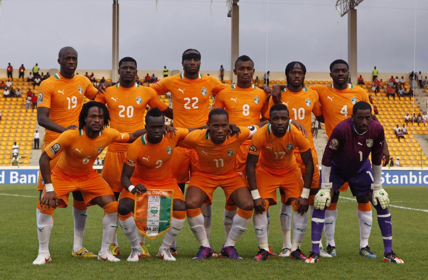 FILE- In this file photo taken on Sunday, Jan. 22, 2012,  Ivory Coast's national soccer team poses for a team picture before the start of their African Cup of Nations Group B match against Sudan at Malabo Stadium in Malabo, Equatorial Guinea,  Back row, from left, are Yaya Toure, Igor Lolo, Souleymane Bamba, Salomon Kalou, Gervinho, Kolo Toure. Front row, from left, are Jean-Jacques Gosso Gosso, Cheick Tiote, captain Didier Drogba, Siaka Tiene, and goalkeeper Boubacar Barry. After Morocco was stripped of hosting rights, the African Cup of Nations is back in the tiny Central African nation of Equatorial Guinea for the second time in three years. (AP Photo/Rebecca Blackwell, File)