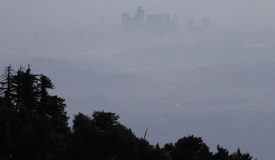 FILE - This April 15,2013 file photo shows the hazy skyline of Los Angeles seen from Mount Wilson, Calif. A sensor atop the Los Angeles County mountain has found that methane emissions in the area are up to 61 percent higher than government estimates.  (AP Photo/Jae C. Hong, File)