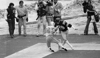 FILE - In this Jan. 6, 1980, file photo, Houston Oilers' Mike Renfro (82) falls out of the endzone after catching a third quarter pass from Dan Pastorini as Pittsburgh Steelers Ron Johnson (29) defends during the AFC Championships game in Pittsburgh. The officials ruled it was not a touchdown. The Steelers won 27-13. (AP Photo/File)