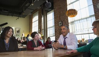 President Obama speaks with, from left, Vika Jordan, Amanda Rothschild, and Mary Stein about proposed legislation to offer paid sick leave for working Americans, during a stop at Charmington's Cafe in Baltimore, Thursday, Jan. 15, 2015. Earlier, the president signed a memorandum is to direct federal agencies to advance six weeks of paid sick leave that federal workers could use as paid family leave. Workers would have to pay back the sick leave over time. (AP Photo/Evan Vucci)