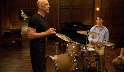 """This image released by Sony Pictures Classics shows J.K. Simmons , left, and Miles Teller in a scene from """"Whiplash."""" The film was nominated for an Oscar Award for best feature on Thursday, Jan. 15, 2015. Simmons was also nominated for best supporting actor for his role in the film. The 87th Annual Academy Awards will take place on Sunday, Feb. 22, 2015 at the Dolby Theatre in Los Angeles. (AP Photo/Sony Pictures Classics, Daniel McFadden)"""