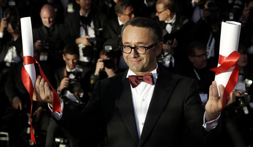 "FILE - In this Saturday, May 24, 2014 file photo, director Andrey Zvyagintsev poses after winning the Best Screenplay award for the film Leviathan during a photo call following the awards ceremony at the 67th international film festival, Cannes, southern France.  Five movies that tackle the cruelties of existence with humanity and humor are finalists for the Academy Award for best foreign-language film. The finalists announced Thursday, Jan. 15, 2015  include director Andrey Zvyagintsev's ""Leviathan,"" a tragic parable of small-town Russian corruption; Pawel Pawlikowski's ""Ida,"" in which an aspiring Polish nun confronts dark truths about her family and her country; and ""Tangerines,"" an Estonian-Georgian film by Zaza Urushadze set in post-Soviet Georgia of the early 1990s. (AP Photo/Thibault Camus, File )"