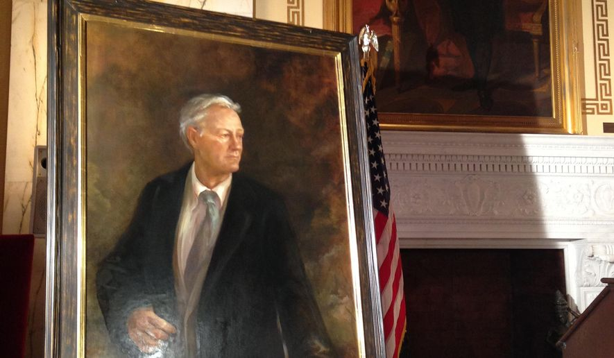 An official portrait of former Rhode Island Gov. Lincoln Chafee rests in the Statehouse near a painting of George Washington, Thursday, Jan. 15, 2015, in Providence, R.I.  Chafee, who did not attend the unveiling, chose Providence artist Julie Gearan to paint his likeness. (AP Photo/Jennifer McDermott)