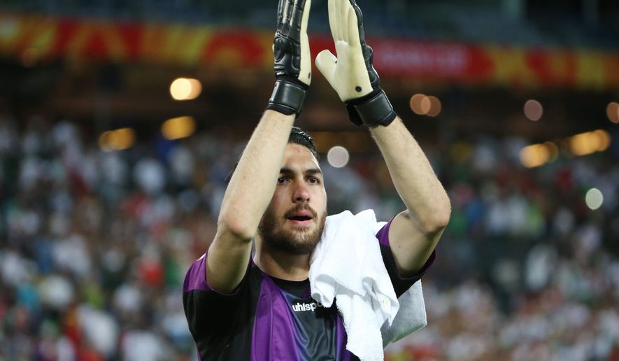 Iran's goalkeeper Alireza Haghigh waves to the crowd following their win over Qatar in their AFC Asia Cup soccer match in Sydney, Australia, Thursday, Jan. 15, 2015. (AP Photo/Rick Rycroft)