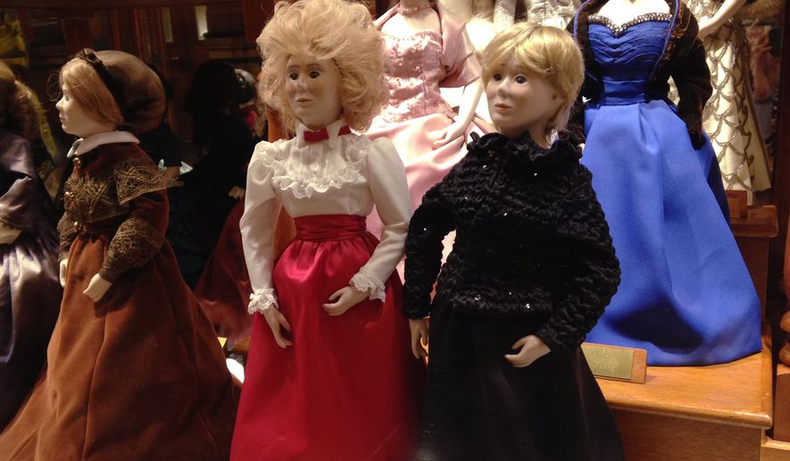 In this Jan. 14, 2015 photo are dolls wearing the 2011, right front, and 1983, center, inaugural gown of Iowa first lady Chris Branstad in a case displaying the gowns of first ladies in the Iowa State Capitol in Des Moines. While Chris Branstad has two dolls in the case, because Branstad has served two different stints in office, no new doll will be made to commemorate Branstad's sixth inauguration. A spokesman says the custom is to create a doll for the inauguration of a new governor, not for every inaugural ball. (AP Photo/Catherine Lucey)