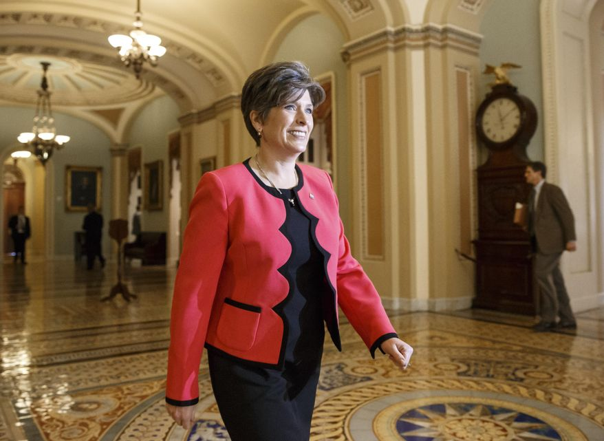 In this Nov. 12, 2014, file photo, then-Sen.-elect Joni Ernst, R-Iowa, walks on Capitol Hill in Washington. Republican officials have tapped newly elected Ernst to deliver the party's formal response to President Barack Obama's State of the Union address on Tuesday. (AP Photo/J. Scott Applewhite, File)