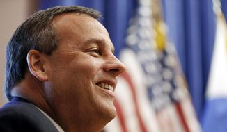 New Jersey Gov. Chris Christie attends a gathering to announce that Seton Hall University and the parent company of Hackensack University Medical Center are planning to build a private medical school, Thursday, Jan. 15, 2015, in Nutley, N.J. (AP Photo/Julio Cortez)