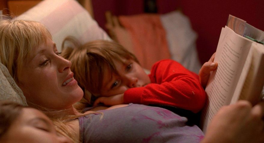 """This image released by IFC Films shows Patricia Arquette and Ellar Coltrane in a scene from the film, """"Boyhood."""" (AP Photo/IFC Films)"""
