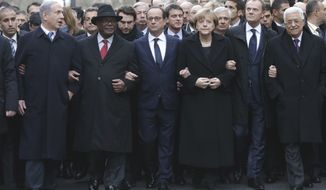 From left, Israeli Prime Minister Benjamin Netanyahu, Malian President Ibrahim Boubacar Keita, French President Francois Hollande, German Chancellor Angela Merkel, EU President Donald Tusk and Palestinian Authority President Mahmoud Abbas march during a rally in Paris, Sunday, Jan. 11, 2015.  (AP Photo/Philippe Wojazer, Pool) ** FILE **
