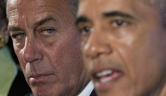 House Speaker John Boehner, left, listens as President Barack Obama speaks to media during his meeting with bipartisan, bicameral leadership of Congress  to discuss a wide range of issues, Tuesday, Jan. 13, 2015, in the Cabinet Room of the White House in Washington. (AP Photo/Carolyn Kaster)