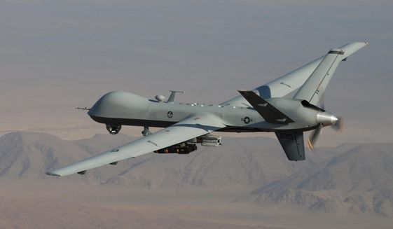 In this undated handout file photo provided by the U.S. Air Force, a MQ-9 Reaper, armed with GBU-12 Paveway II laser guided munitions and AGM-114 Hellfire missiles, is piloted by Col. Lex Turner during a combat mission over southern Afghanistan. (AP Photo/Lt. Col.. Leslie Pratt, US Air Force, File)