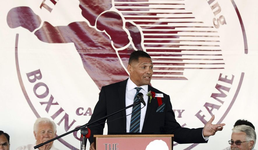 FILE - In this June 9, 2013 file photo, Virgil Hill, a five-time world champion who won a silver medal at the 1984 Olympics and defended his light heavyweight title 20 times over his two reigns, addresses the crowd while accepting his induction into the International Boxing Hall of Fame in Canastota, N.Y. Hill, who is from North Dakota and turns 51 on Sunday, Jan. 18, 2015, is stepping into the ring for a final time Feb. 28 when he is scheduled to fight Seattle boxer Roger Cantrell at the Bismarck Event Center in Bismarck, N.D. (AP Photo/Heather Ainsworth, File)