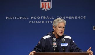 Seattle Seahawks coach Pete Carroll talks to reporters Wednesday, Jan. 14, 2015, before NFL football practice in Renton, Wash. The Seahawks are scheduled to face the Green Bay Packers on Sunday in the NFC championship game. (AP Photo/Ted S. Warren)