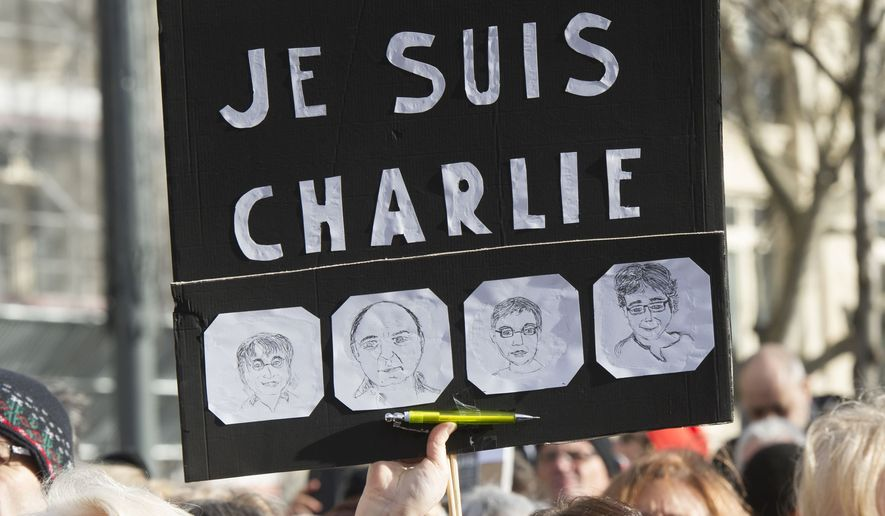 Anti-terrorism marchers in Paris display solidarity with Charlie Hebdo cartoonists killed in the Jan. 7 attacks in the city, which left 17 dead. (Rex Features via AP Images)