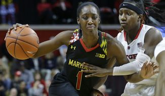 Maryland guard Laurin Mincy (1) dribbles drives on Rutgers guard Syessence Davis during the second half of an NCAA college basketball game Thursday, Jan. 15, 2015, in Piscataway, N.J. Maryland won 71-59. Mincy had 24 points for Maryland.  (AP Photo/Mel Evans)