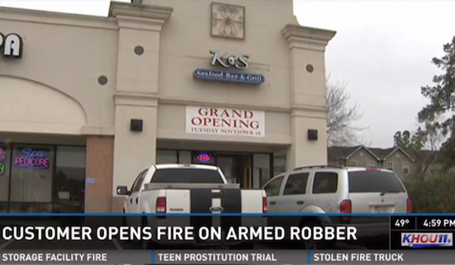 A gun-carrying customer is being hailed a hero after reportedly thwarting a robbery Saturday at the new K&S Seafood Bar and Grill in Houston. (KHOU 11)