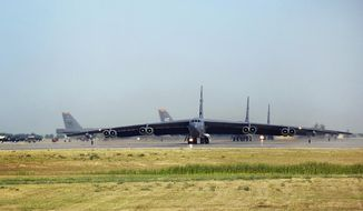 In this Aug. 9, 2007, file photo, B-52 bombers taxi to the runway at  Minot Air Force Base in Minot, N.D. (AP Photo/The Daily News, Eloise Ogden, File)