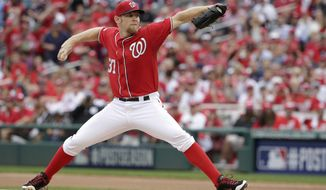 FILE - In this Oct. 3, 2014 file photo, Washington Nationals starting pitcher Stephen Strasburg (37) pitches in a baseball game against the San Francisco Giants at Nationals Park in Washington. Strasburg and the Nationals have agreed to a $7.4 million, one-year contract and  avoided salary arbitration. (AP Photo/Pablo Martinez Monsivais, File)