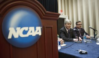 NCAA President Mark Emmert, left, and Division 1 board of directors member Kirk Schulz, Kansas State University president, speak with reporters during a news conference at the NCAA Convention in Oxon Hill, Md., Friday, Jan. 16, 2015.  (AP Photo/Cliff Owen) **FILE**