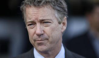 U.S. Sen. Rand Paul, R-Ky., speaks with the media at the Peppermill restaurant Friday, Jan. 16, 2015, in Las Vegas. Paul is a possible Republican presidential candidate. (AP Photo/John Locher) ** FILE **