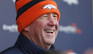 FILE - In this Jan. 7, 2015, file photo, Denver Broncos head coach John Fox jokes with reporters after practice for the team's NFL football divisional playoff game against the Indianapolis Colts in Englewood, Colo.  The Chicago Bears have reached an agreement with John Fox to become the teams head coach, Friday, Jan. 16, 2015. (AP Photo/David Zalubowski, File)