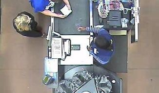 In this January 2015 photo made from surveillance video and released by the Grayson County Sheriff's Office, in Kentucky, 18-year-old Dalton Hayes and 13-year-old Cheyenne Phillips stand at a checkout station at a South Carolina Wal-Mart. Authorities are looking for the teenage couple from central Kentucky who are suspected in a multistate crime spree. (AP Photo/Wal-Mart Inc. via The Grayson County (Ky.) Sheriff's Office)