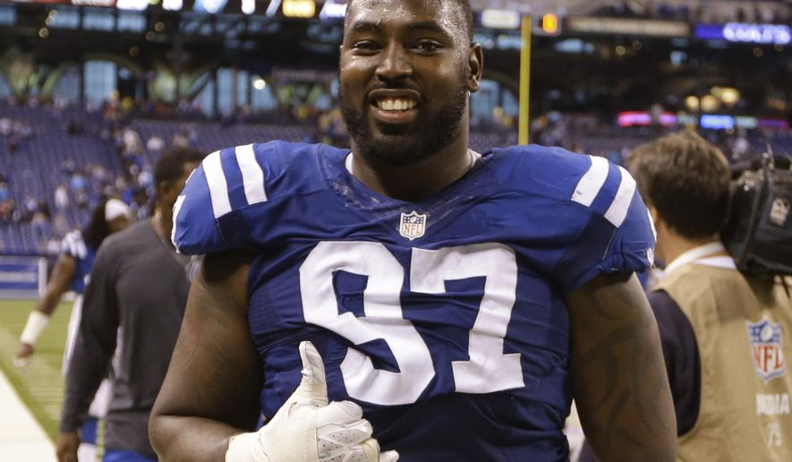 FILE - In this Nov. 23, 2014, file photo, Indianapolis Colts defensive end Arthur Jones (97) reacts following an NFL football game against the Jacksonville Jaguars in Indianapolis. Brothers Chandler and Arthur Jones willl be on opposing defenses in the AFC title game. (AP Photo/Michael Conroy, File)