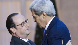 France's President Francois Hollande, left,  welcomes U.S. Secretary of State John Kerry, at the Elysee Palace in Paris,  Friday Jan. 16, 2015. Kerry arrived on Friday in the French capital for American solidarity with the French people after last week's deadly terrorist attacks. (AP Photo/Jacques Brinon)