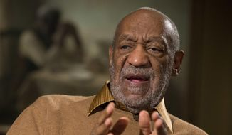 "This photo taken Nov. 6, 2014, shows entertainer Bill Cosby gesturing during an interview about the upcoming exhibit, ""Conversations: African and African-American Artworks in Dialogue,"" at the Smithsonian's National Museum of African Art in Washington. (AP Photo/Evan Vucci, File)"