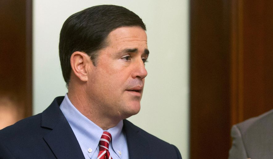 Gov. Doug Ducey talks about his budget before it's release at the Executive Tower in Phoenix on Friday,  Jan. 16, 2015. (AP Photo/The Arizona Republic, Cheryl Evans) ** FILE **