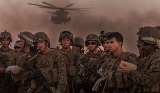 Marine Infantry Officer Course students await a CH-53E Super Stallion helicopter fast rope drill on the Marine Corps Air Station Yuma, Ariz., Auxiliary Landing Field 2, Wednesday, August 18, 2014. (U.S. Marine Corps) FILE **