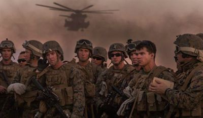 Marine Infantry Officer Course students await a CH-53E Super Stallion helicopter fast rope drill on the Marine Corps Air Station Yuma, Ariz., Auxiliary Landing Field 2, Wednesday, August 18, 2014. (U.S. Marine Corps)