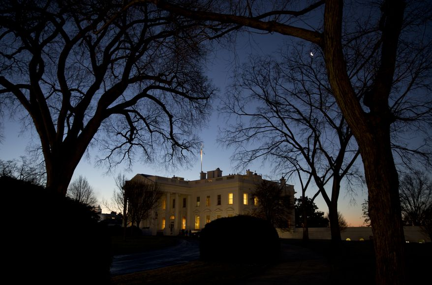 The White House is seen as the sun rises in Washington, Friday, Jan. 16, 2015. (AP Photo/Carolyn Kaster)