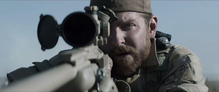 "Actor Bradley Cooper stars as Chris Kyle in the movie ""American Sniper."" (2014 Warner Bros. Entertainment Inc.)"