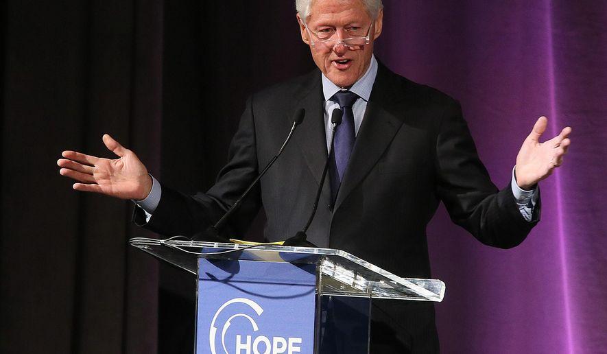Former President Bill Clinton speaks at the Hope Global Forum in Atlanta on Saturday, Jan. 17, 2015. (AP Photo/Phil Skinner)