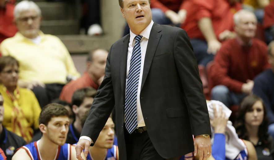 Kansas head coach Bill Self watches from the bench during the first half of an NCAA college basketball game against Iowa State, Saturday, Jan. 17, 2015, in Ames, Iowa. (AP Photo/Charlie Neibergall)