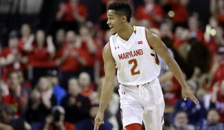 Maryland guard Melo Trimble reacts after scoring a 3-point basket in the first half of an NCAA college basketball game against Michigan State, Saturday, Jan. 17, 2015, in College Park, Md. (AP Photo/Patrick Semansky)