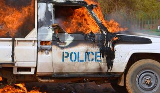 A police vehicle burns in Niger's capital Niamey on Jan. 17, 2015 during Charlie Hebdo protests. (Image: Twitter, BBC)