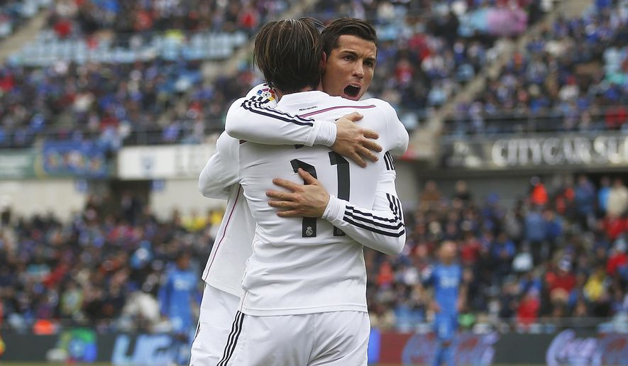 Real Madrid's Gareth Bale, left, celebrates his goal with Real Madrid's Cristiano Ronaldo, right, during a Spanish La Liga soccer match between Getafe and Real Madrid at the Coliseum Alfonso Perez stadium in Madrid, Spain, Sunday, Jan. 18, 2015. (AP Photo/Andres Kudacki)
