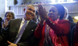 U.S. Rep. William Lacy Clay, D-Mo., left, smiles alongside fellow Congressional Black Caucus member Rep. Shelia Jackson Lee, D-Texas, during a service at Wellspring Church, Sunday, Jan. 18, 2015, in Ferguson, Mo. (AP Photo/Jeff Roberson) ** FILE **