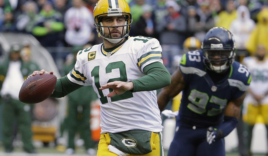 Green Bay Packers' Aaron Rodgers throws during the second half of the NFL football NFC Championship game against the Seattle Seahawks Sunday, Jan. 18, 2015, in Seattle. (AP Photo/Ted S. Warren)
