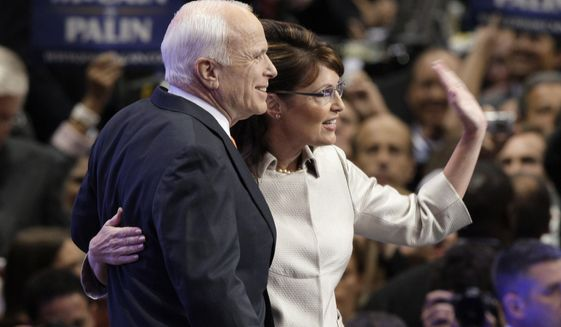 In this Sept. 3, 2008 file photo, then-Republican Presidential candidate, Sen. John McCain, R-Ariz., and his running mate Sarah Palin waves to the crowd as she is joined by McCain at the end of her speech at the Republican National Convention in St. Paul, Minn. (AP Photo/Paul Sancya, File)