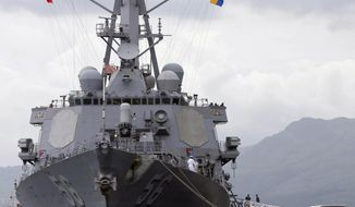 FILE - In this June 26, 2014 file photo, the U.S. Navy warship USS John McCain, an Arleigh-Burke class destroyer, is docked at the Subic Freeport to take part in the joint US-Philippines naval exercise  called Cooperation Afloat Readiness And Training (CARAT) at the former US naval base of Subic, about 70 miles west of Manila, Philippines.   After two unsuccessful presidential bids, Sen. John McCain, R-Ariz., the 78-year-old former Navy pilot and Vietnam prisoner of war has rebounded as the chairman of the powerful Senate Armed Services Committee.  (AP Photo/Bullit Marquez, File)
