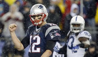 New England Patriots quarterback Tom Brady (12) celebrates LeGarrette Blount's touchdown during the second half of the NFL football AFC Championship game against the Indianapolis Colts Sunday, Jan. 18, 2015, in Foxborough, Mass. (AP Photo/Elise Amendola)