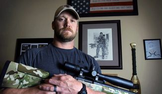 "Former Navy SEAL and author of the book ""American Sniper"" Chris Kyle poses in Midlothian, Texas. (AP Photo/The Fort Worth Star-Telegram, Paul Moseley)"